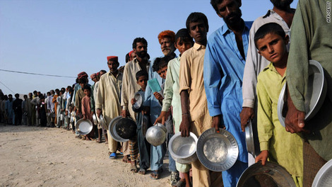 CNN Flood victims wait for food and water at a makeshift camp in Sukkur on August 23, 2010