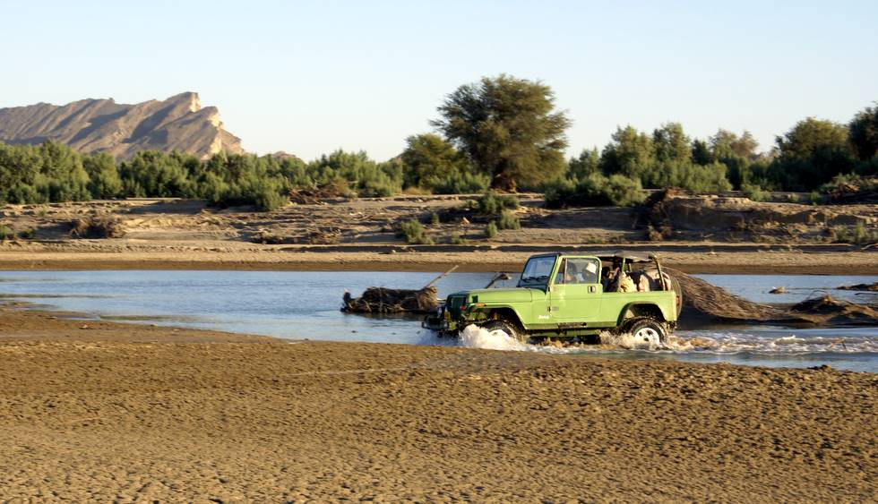 TM's Wrangler crossing the river