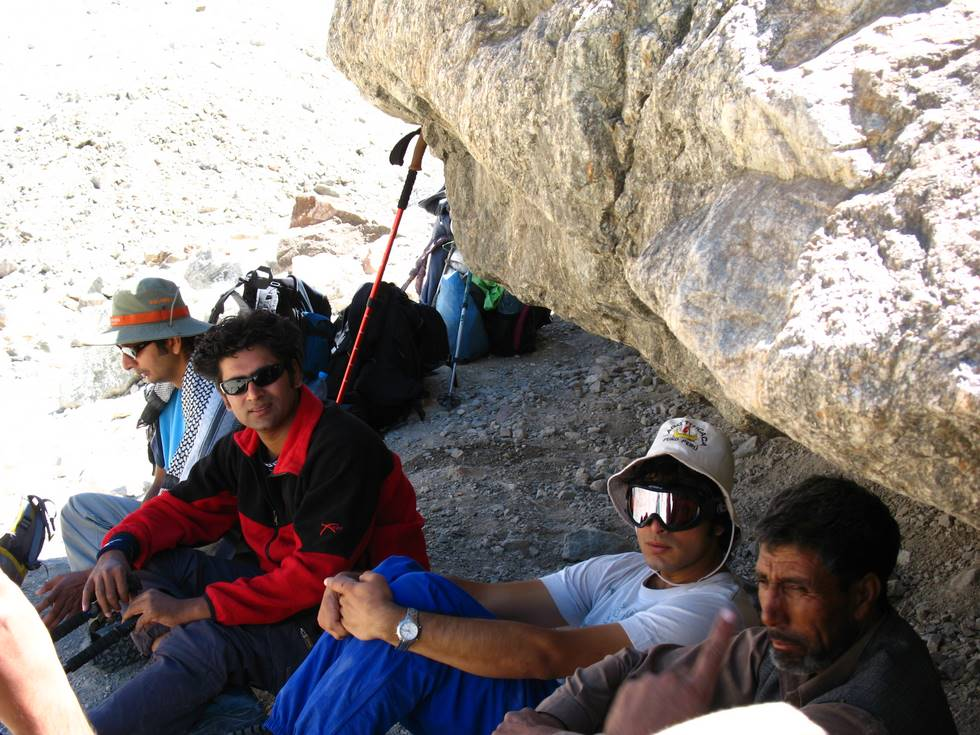 Resting underneath a big rock
