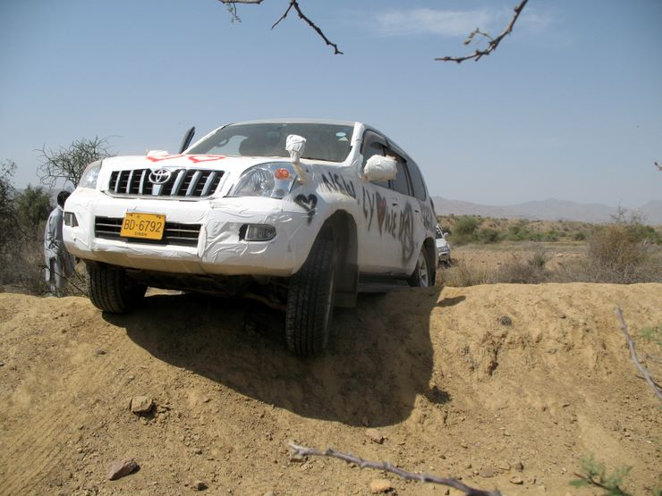 1st day 1st vehicle stuck!  The Prado had one front and one rear wheel in the air  - had to be  winched out!